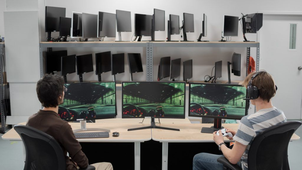 Boys playing games on g-sync enabled monitors