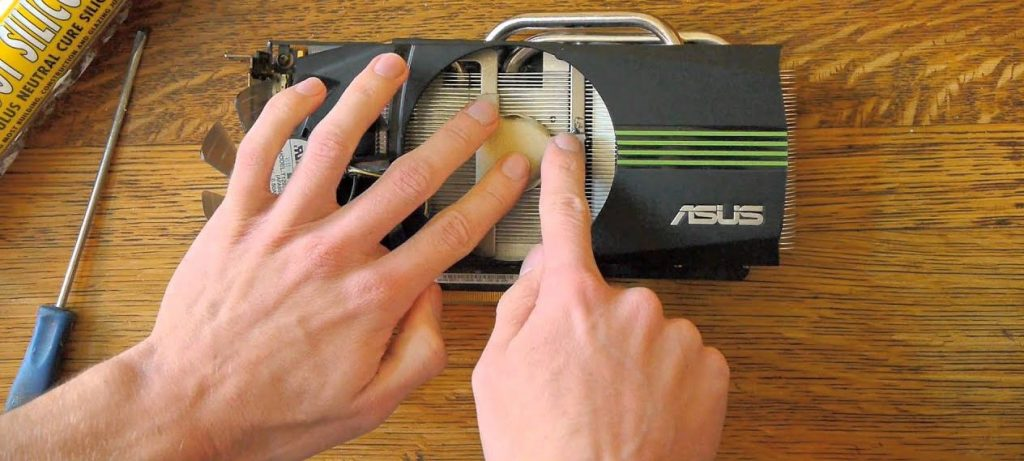 A asus graphics card on a wooden table