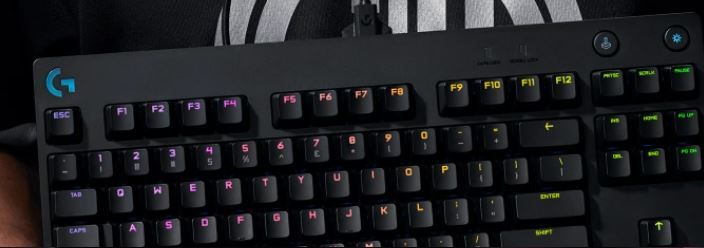 Person holding a gaming keyboard