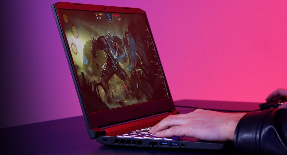 Person playing video games on gaming laptop