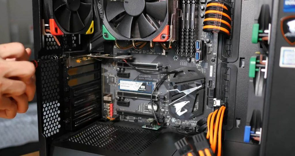 Person showing tho connect motherboard in pc case