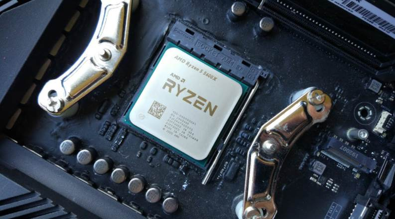 Image of Ryzen 5 5600x CPU inside a Motherboard