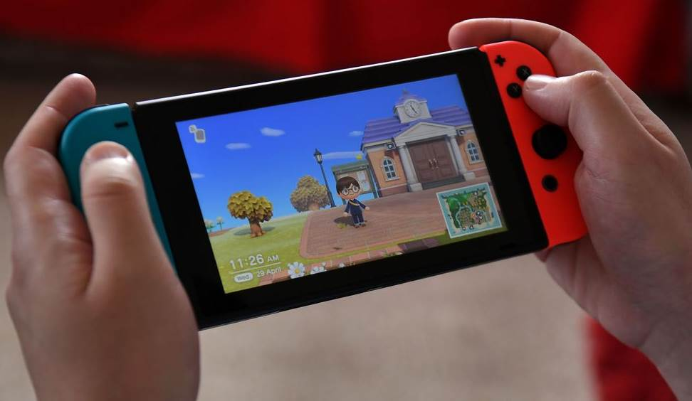 Image of a person playing the animal crossing on switch