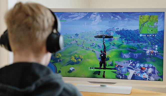 Image of person playing fortnite on TV