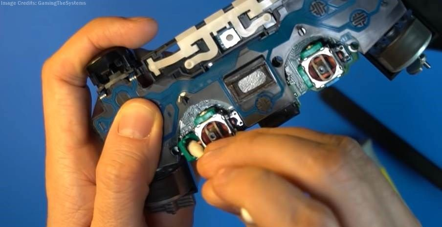 image of cleaning the ps4 stick with isopropyl alcohol