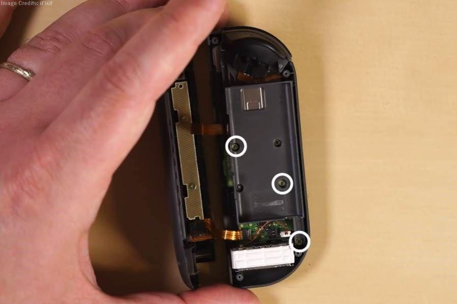 showing three screws in joy con