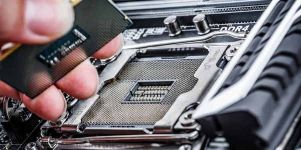 Image of a person inserting the CPU into Mobo