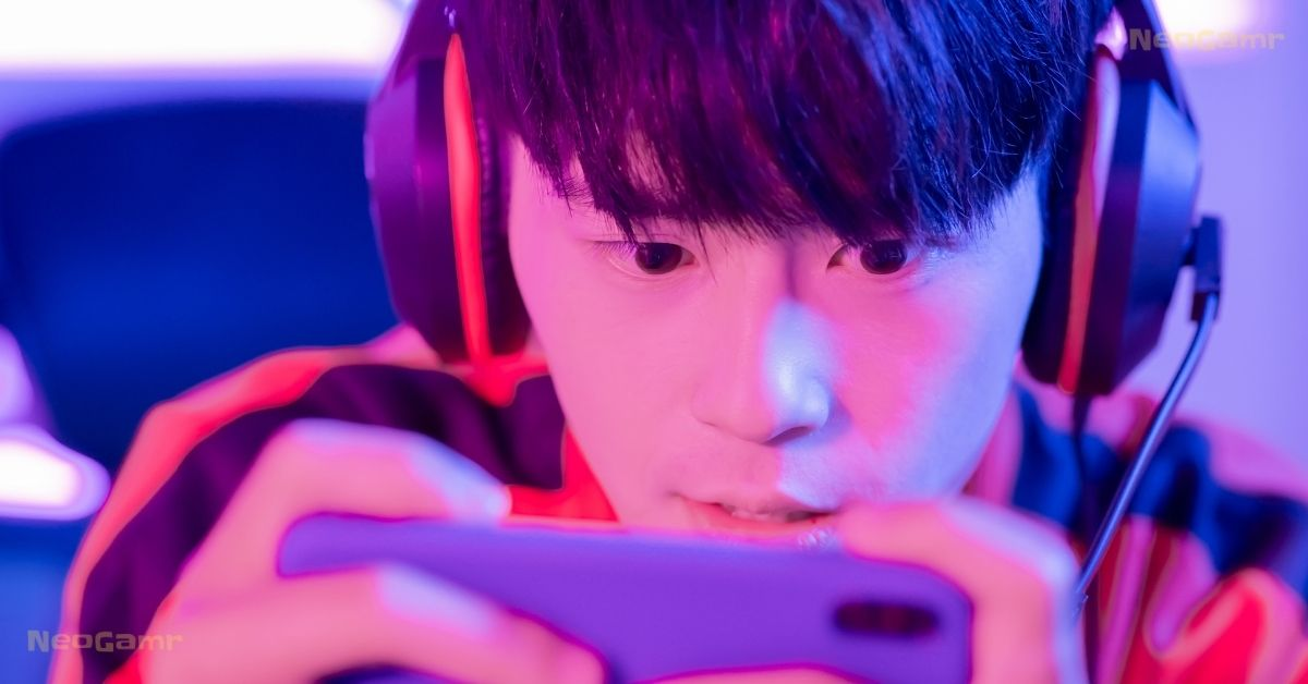 A boy playing mobile games